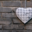 Decorative heart on the brick wall — Stock Photo #12072176