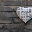 Decorative heart on the brick wall — Stock Photo
