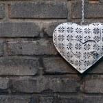 Decorative heart on the brick wall — Stock Photo #12072195