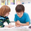 Young boys reading story book — Stock Photo #10787601