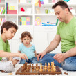 Whoa - that is awsome, toddler boy looking at chess game — Stock Photo