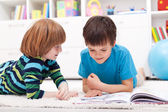 Young boys reading story book — Stock Photo
