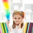 Little girl dusting in her room — Stock Photo