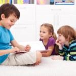 Kids reading funny story — Stock Photo