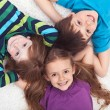 Kids laying on the floor together — Stockfoto #10984976