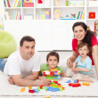 Stock Photo: Family time - young parents with two kids playing