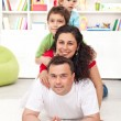 Happy young family portrait - Stock Photo