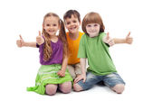 Three kids giving thumbs up sign — Stock Photo