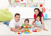 Family time - young parents with two kids playing — Stock Photo