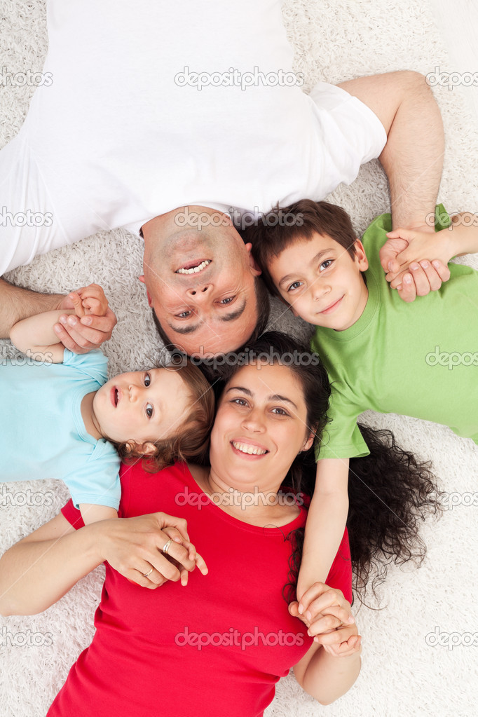 Happy family with two kids - portrait on the floor  Stock Photo #10985033