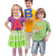 Back to school - kids holding large abc letters — Stock Photo