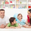 Royalty-Free Stock Photo: Young family playing in the kids room