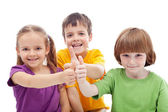 Friends forever - kids showing thumbs up signs — Stock Photo