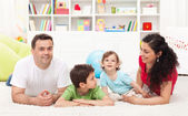 Young family playing in the kids room — Stock Photo