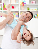Father playing with toddler son — Stock Photo