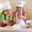 Kids preparing a cake - starting with flour and eggs - Stock Photo
