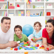 Royalty-Free Stock Photo: Kids with their parents playing
