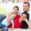 Happy young family with two kids — Stock Photo
