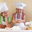 Kids preparing the dough for a cookie, pizza or pasta — Stock Photo