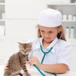 Little girl playing at the vet — Stock Photo