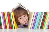 Mischievous kid with freckles and books — Stock Photo