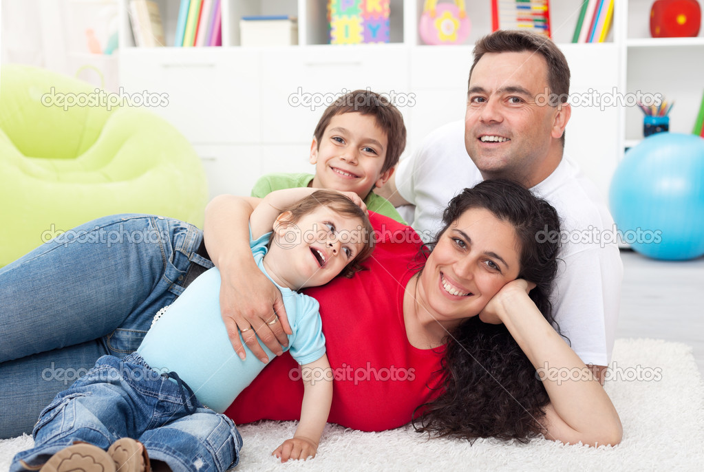 Happy young family with two small kids together at home  Stock Photo #11656793
