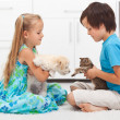 Kids with their pets - dog and cat — Stock Photo
