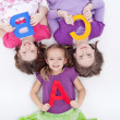 Stock Photo: Girls holding B C letters