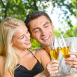 Young happy couple with champagne, outdoor — Stock Photo