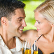 Young happy couple with champagne, outdoor — Stock Photo #10795364
