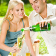 Young happy couple with champagne, outdoor — Stock Photo #10795382