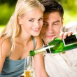 Young happy couple with champagne, outdoor — Stock Photo #10795389