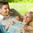 Young couple reading together, outdoor — Stock Photo #10795393