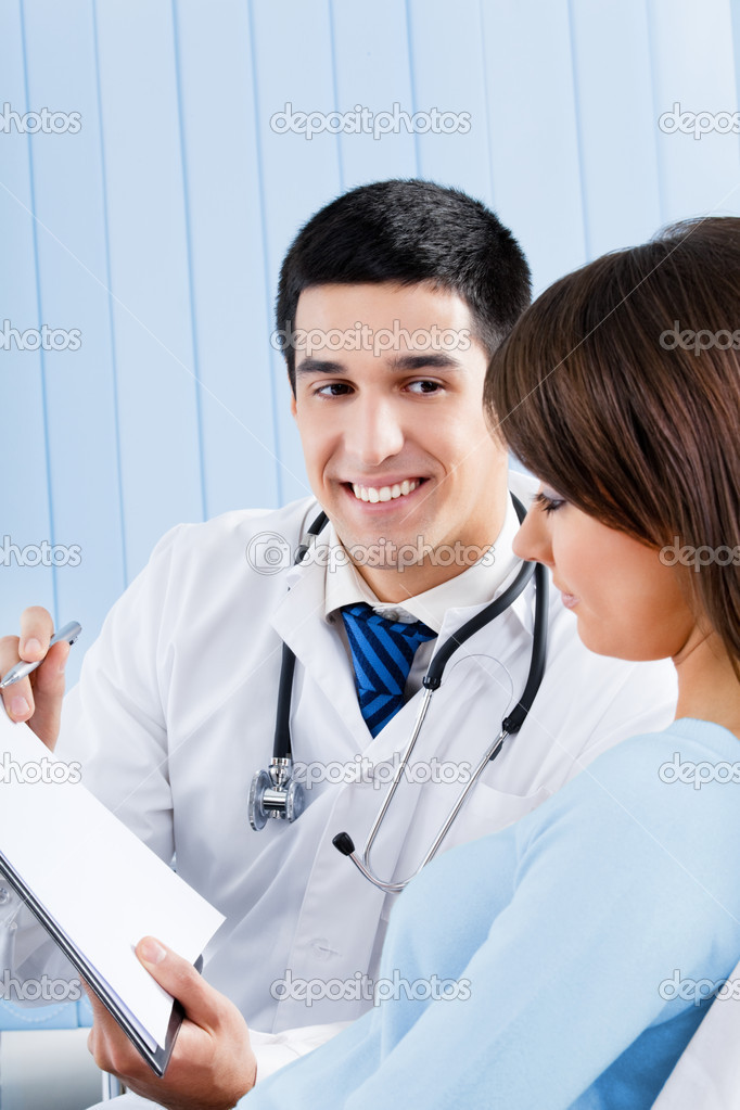 Young doctor and female patient with prescription at office — Stock Photo #10795707