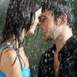 Young couple hugging under a rain — Stock Photo #11211228