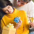 Couple with champagne and gifts — Photo
