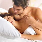 Young amorous couple at bedroom — Stock Photo