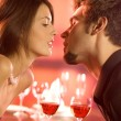 Couple kissing on romantic date — Stock Photo
