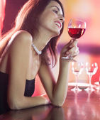 Young woman with redwine at restaurant — Stock Photo