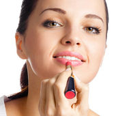 Woman applying lipstick, isolated — Stock Photo