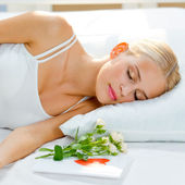 Sleeping woman with roses and valentine card — Stock Photo
