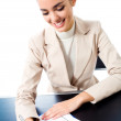 Businesswoman writing at office, isolated — Stock Photo