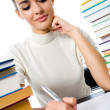 Writing woman with textbooks, isolated — Stock Photo