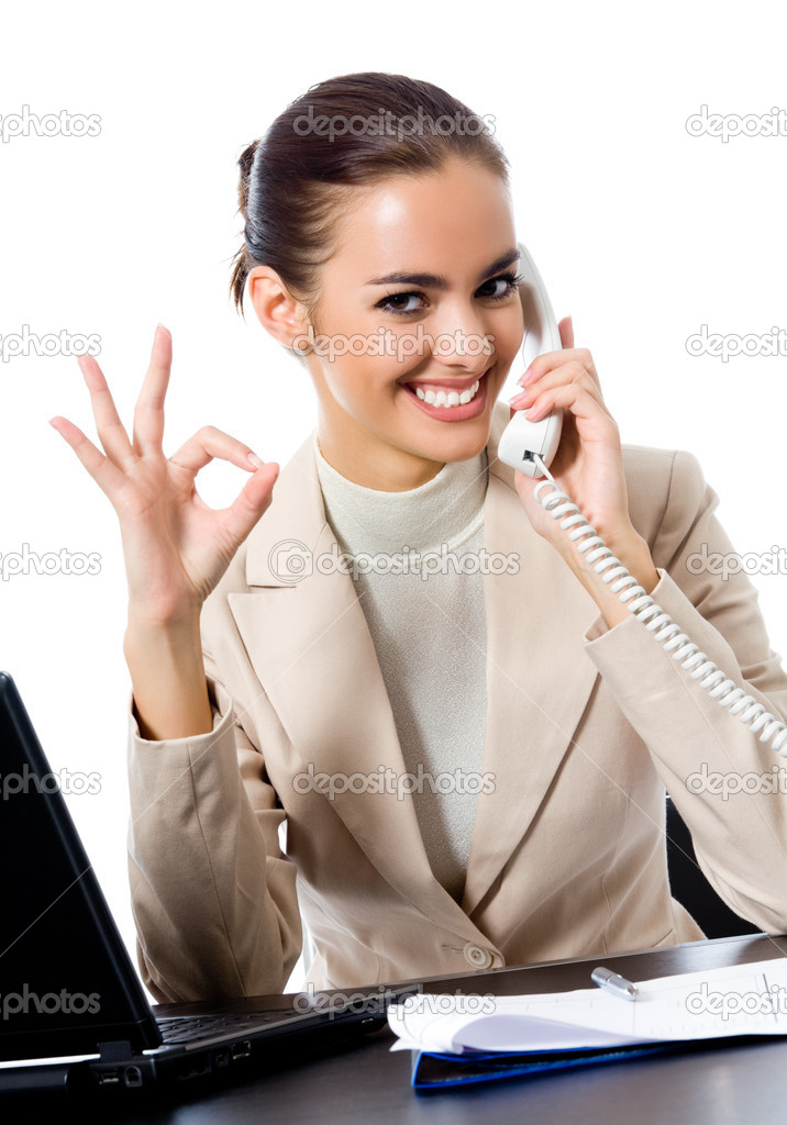 Business woman with phone showing thumbs up sign, at office, isolated over white background — Stock Photo #11703193