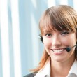 Cheerful smiling support phone operator at office — Stock Photo #11931151