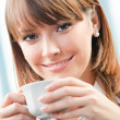 Royalty-Free Stock Photo: Cheerful smiling business woman with coffee