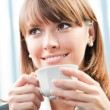 Cheerful smiling business woman with coffee — Stock Photo