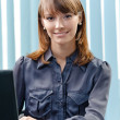 Young business woman with laptop — Stock Photo #11931201