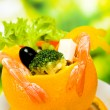 Royalty-Free Stock Photo: Orange stuffed by vegetarian salad with shrimps