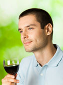 Thinking man with redwine, outdoors — Stock Photo